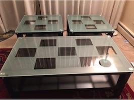 I have a set of beautiful chess patterned coffee tables.  Great for kids because the edges aren't sharp. They are made with quality glass. Thick glass, and the bottom is made out of wood and the coffee table has wheels. Very beautiful piece. Goes great wi
