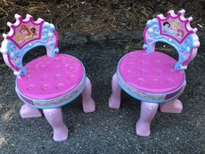 two toddler's Disney Princesses pink chairs