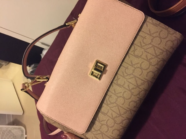 ef736c40b5d3 Used beige and pink monogram Calvin Klein leather sling bag for sale in  Montréal