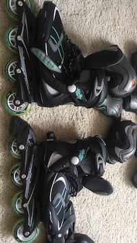pair of black-and-gray inline skates. Size 7
