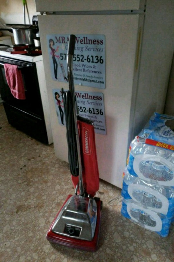 red and gray Dirt Devil upright vacuum cleaner