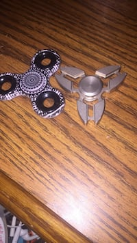 white and black and gray hand spinners