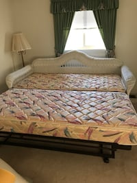 Wicker daubed with trundle bed. Expands to King size bed