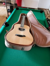 brown natural finish acoustic guitar in case