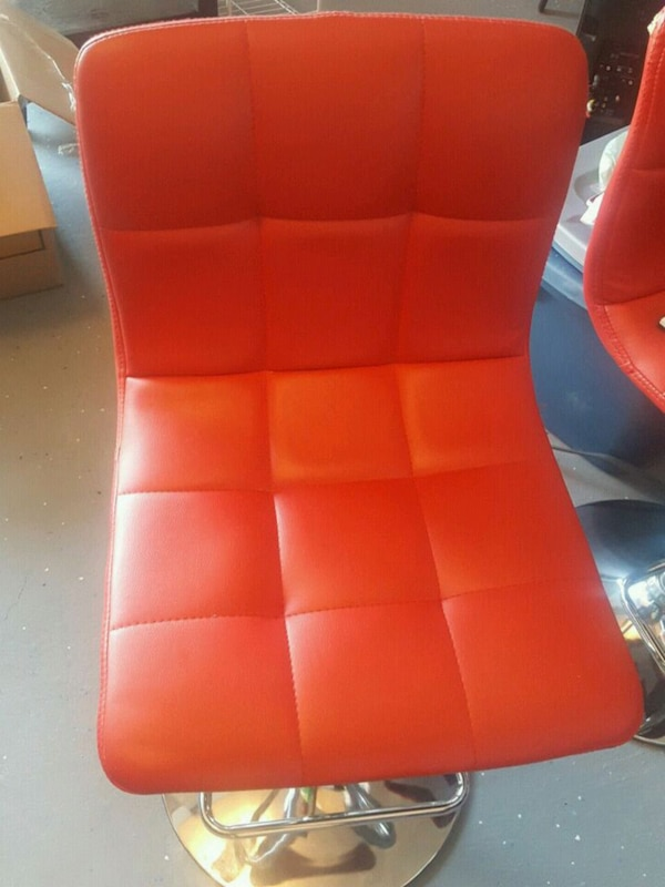 red and black leather padded chair