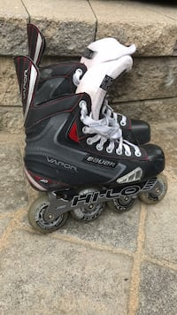 Pair of black-and-white inline skates Toronto, M8W 2L3