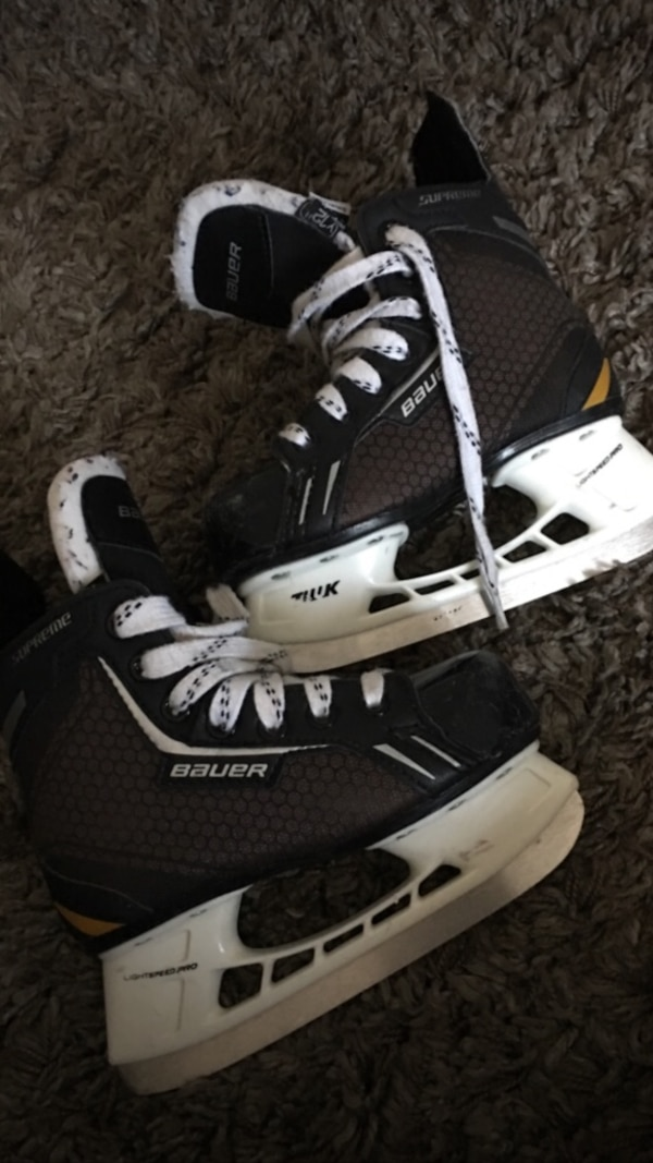 Hockey skates and gloves.  a9aea49c-018c-43ec-b79f-732eb1917001