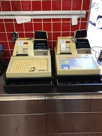two beige and black cash registers 100 each Rutherford, 07070