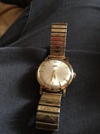 round gold analog watch with gold link bracelet Kawartha Lakes