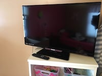 Black flat screen tv with remote 270 mi