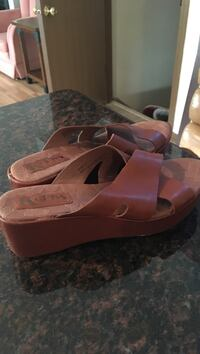 pair of brown Korks leather wedge sandals