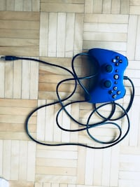 blue and black corded gaming headset Montréal, H2N 1K2