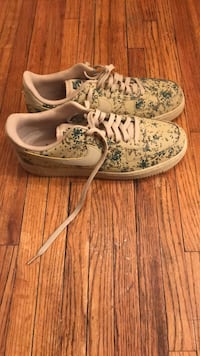 pair of white-and-green floral sneakers New York, 10469