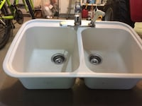 White Corian sink with taps