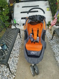 baby's orange and grey jogging stroller 18 km