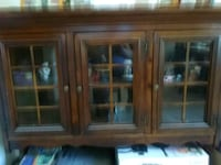 brown wooden framed glass display cabinet Falls Church, 22042