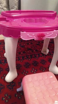 pink and white plastic table