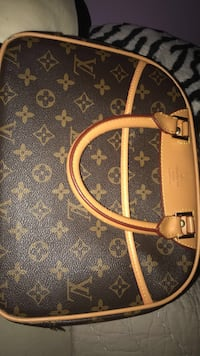 Brown louis vuitton leather handbag Manchester, 03103