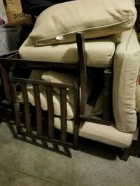 two brown wooden framed white padded chairs Las Vegas, 89141