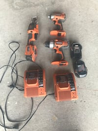orange and black Ridgid cordless power drill and impact driver