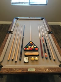 Pool table and all accessories. Also includes a wall rack not shown  Norco, 92860