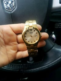 round gold-colored analog watch with link bracelet Vaughan, L4H 0C2