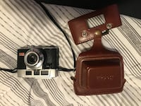 brown leather SLR camera with case Gatineau, J8P 0B2