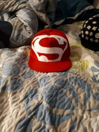 red and white Superman cap