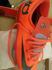 pair of orange-and-white Nike running shoes Alexandria, 22304