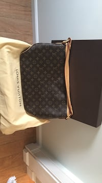 Monogrammed canvas Louis Vuitton leather hobo bag