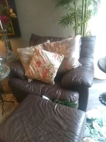 brown leather oversized chair and ottoman.  Must go getting new couch.