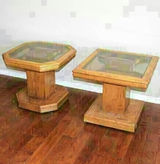 two brown wooden framed glass top side table