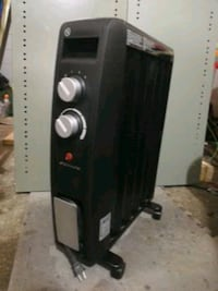 1500w oil free. Electric radiater style Heater London, N5Y 4W5