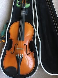 Violin with bow in case. null