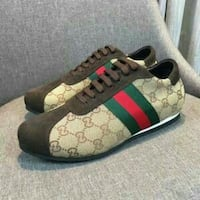 brown-green-and-red monogrammed Gucci lace-up shoes