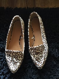 pair of white-and-brown leopard print loafers