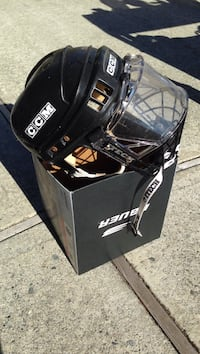 black CCM sports helmet on box Coquitlam, V3K 6Y4