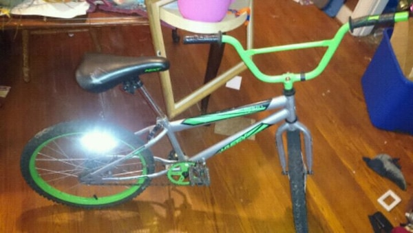 green and white bicycle frame