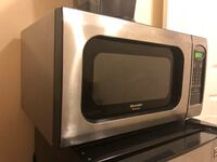 Black and gray microwave by sharp used but in good condition  Centreville, 20120