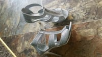 pair of gray open toe ankle strap heels