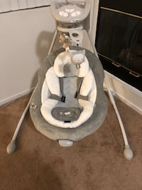 Baby's white and gray cradle and swing .it is brand new never used because my baby doesn't like it with box .