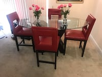 rectangular brown wooden table with four chairs dining set Beltsville, 20705
