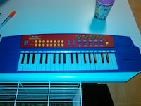 blue and white electronic keyboard