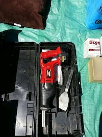 red cordless reciprocating saw in case Surrey, V3W 3V5