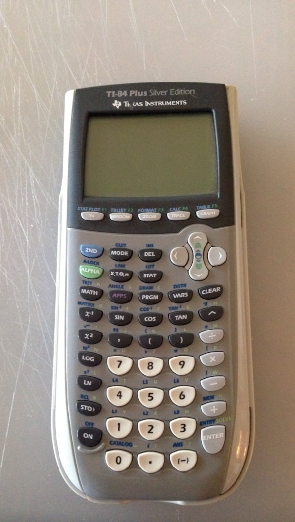 gray Texas Instruments TI-84 plus silver edition graphing calculator