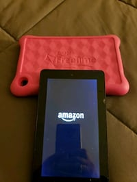 Used Amazon 7 inch tablet with pink kids case.