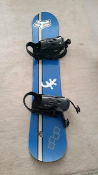 blue and black snowboard with bindings 560 km