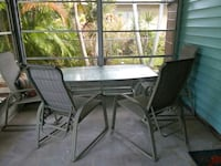 Sturdy patio table with 4 lounge back chairs.