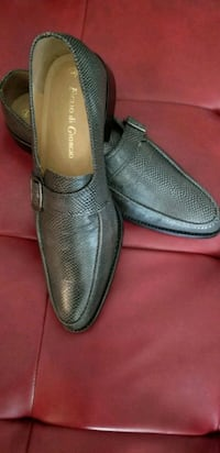 pair of black leather slip-on shoes Spruce Grove, T7X