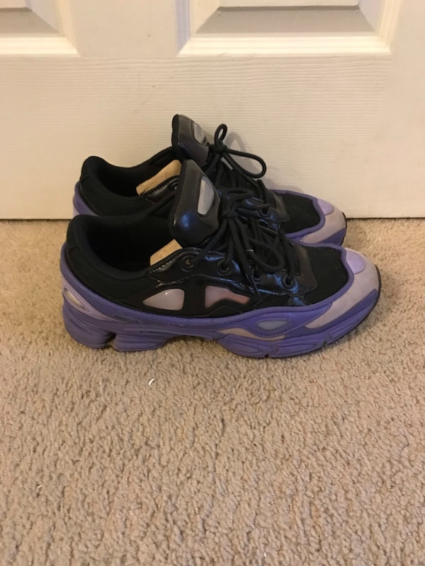 Pair of purple-and-black nike basketball shoes